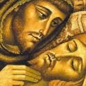 São Francisco de Assis abraça Cristo crucificado
