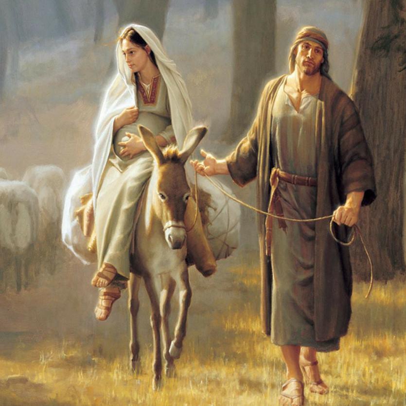 Detalhe de José e Maria grávida, sobre um jumentinho